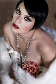 20s style beautiful brunette female wearing fur, exquisite, showing bare shoulders, candor