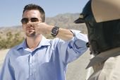 stock photo of sobriety  - Young Man Forced To Take A Field Sobriety Test - JPG