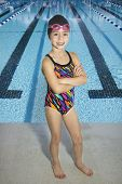 stock photo of swim meet  - Confident Young Swimmer standing by Swimming Pool - JPG