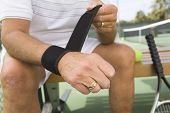 Midsection of a senior tennis player wearing wristband