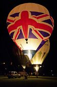 NORTHAMPTON, ENGLAND - AUGUST 18: Hot Air Balloon with union Jack flag launching at night at the Nor