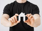 stock photo of possess  - picture of man hands holding paper house - JPG