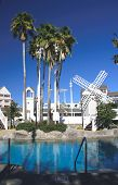 Recreational Resort Poolside With White Windmill poster
