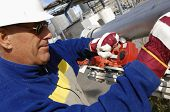 stock photo of factory-worker  - engineer inside oil and gas refinery of pipeline pumps works - JPG