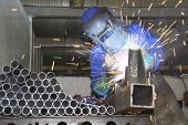 image of flux  - Artisan welding steel tubes on a production line - JPG