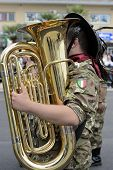 pic of army cadets  - bersagliere with her musical instrument in a parade during the national meeting - JPG