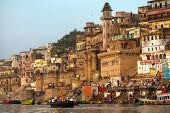 VARANASI, INDIA - 23 MARCH: Ghats on the banks of Ganges river in holy city of Varanasi on March 23,