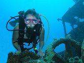 Young Female Scuba Diver On A Wreck Dive Site