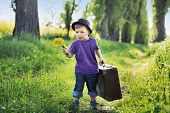 Young boy with big suitcase