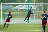 MOSCOW - AUG 23: Female goalkeeper returns ball over bar during opening match between CSP Izmailovo