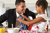 stock photo of cereal bowl  - Daughter Straightens Father - JPG