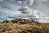 stock photo of sagebrush  - A dramatic sky over the arid High Desert - JPG