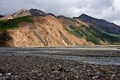 picture of denali national park  - Mountains rise above a river in Denali National Park - JPG