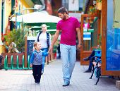 Happy Father And Son Walking The City Street