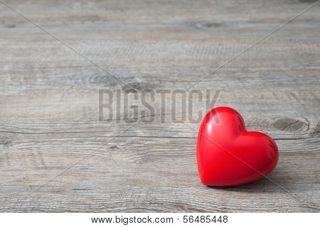 Red Heart On Wooden Background poster