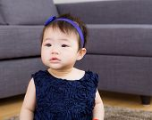 Asian baby girl at home