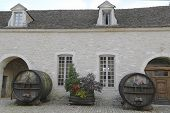 An old painted wine barrels in Chateau de Pommard, Burgundy, France