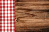 Tablecloth on wooden table background