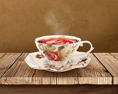 Porcelain tea cup over wooden table with clipping path