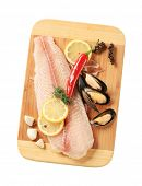 stock photo of pangasius  - Fresh fish fillet and mussels on a cutting board - JPG