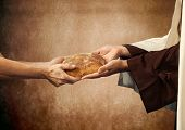 stock photo of beggar  - Jesus gives the bread to a beggar on beige background - JPG