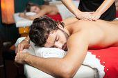 stock photo of chiropractic  - Handsome man having a massage - JPG