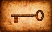 Old Key On Grunge Old Paper Texture