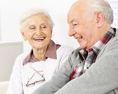 Happy smiling senior couple in a retirement home