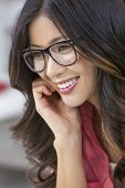 Smiling happy beautiful young Asian Chinese woman or girl wearing geek glasses