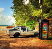 ST.LUCIA - JANUARY 20: Car and telephone booth on Pigeon Island's seashore January 20, 2011 in St. Lucia, Carribean