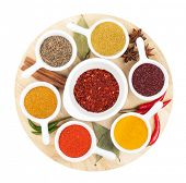 Various spices selection on cutting board. Isolated on white background