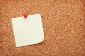 Blank sticky paper on cork wood notice board with copy space
