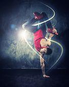 stock photo of break-dancing  - Stylish man dancer showing break - JPG