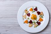 Fried Potatoes, Carrots, Beets And Egg Of Heart On A Plate.