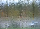 Window Glass And Rain Drops
