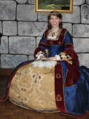 MUSKOGEE, OK - MAY 24: A woman dressed in historical costume stops for the picture at the Oklahoma 19th annual Renaissance Festival on May 24, 2014 at the Castle of Muskogee in Muskogee, OK.