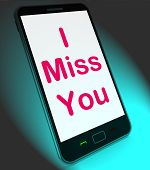 stock photo of miss you  - I Miss You On Mobile Meaning Sad Longing Relationship - JPG