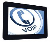 stock photo of voip  - Voip Tablet Meaning Voice Over Internet Protocol Or Broadband Telephony - JPG