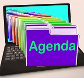 stock photo of lineup  - Agenda Folders Laptop Showing Schedule Lineup Or Timetable - JPG