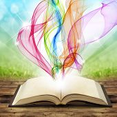 pic of fiction  - open book with colored smoke swirls and twirls - JPG