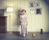 Surprised beautiful girl in the vintage interior. Creative concept