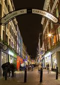 Carnaby Street At Night With The Blur Of People Walking Past
