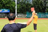Hand Of Referee With Red Card