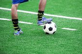 Soccer Player's Feet Stepping Onto A Soccer Ball