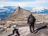 Hiker Walking at the Top of Mount Kinabalu in Sabah, Malaysia
