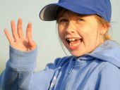 Young girls waves greeting