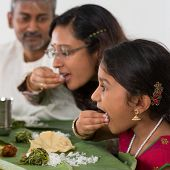 stock photo of malaysian food  - Indian family dining at home - JPG