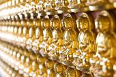 Ten Thousand Golden Buddhas Lined Up Along The Wall Of Chinese Temple In Thailand.