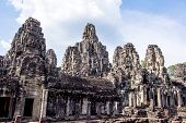 Siem Reap, Cambodia - May 3, 2014:  Tourist travel Bayon temple in Angkor Thom.