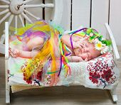 stock photo of national costume  - newborn girl sleeping in the Ukrainian national costume - JPG
